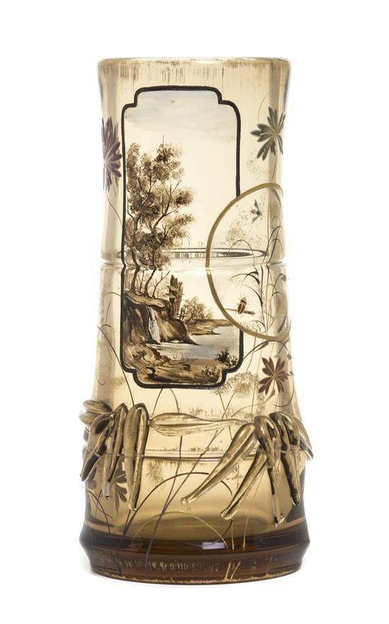 An Emile Galle Enameled and Applied Glass Vase, (French, 1846-1904), of segmented tapering form, decorated in the Aesthetic taste with a landscape, fish and applied bamboo, etched E. Galle Nancy to base. Height 11 1/8 inches. Estimate $4,000-6,000, Sold for: $11,250