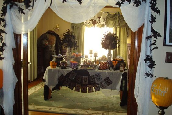 These are some pics of our trick or treat station from last year.  We did this for our open house for our friends who have kids.  Treats included: orange soda, root beer, candy drizzled popcorn, M&M's, gumballs, rock candy pops, swirl lollipops, chocolate dipped pretzel rods, bags of assorted funsize candy, Jelly Belly beans, candy corn cauldrons, glitter spider rings, bags of cobwebs, play dough, note pads, pencils, coloring books, and hand sanitiz