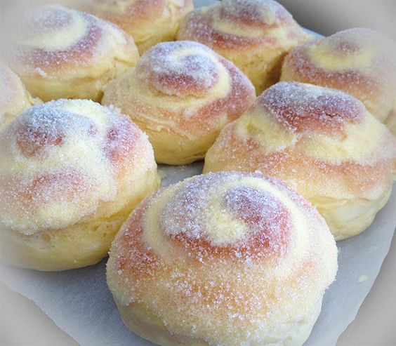 This Ensaymada Recipe also known as Filipino Sweet Buns is a sweet and cheesy bread usually eaten partnered with coffee. Recipe includes flour, cheese etc.