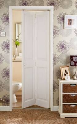 Toilets guest rooms and folding doors on pinterest for Small bathroom entry door ideas