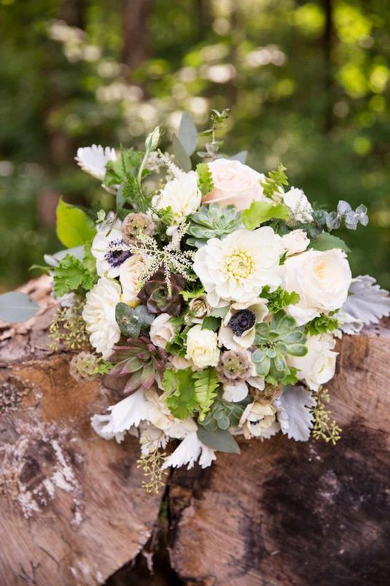 """Beautifully Rustic Virginia Mountain Wedding Flowers: Flowers included succulents in different shapes and sizes, white anemones with black centers, the David Austin roses, """"Patience"""", anemones with black eyes, white dahlias, porcelena spray roses and white O'Hara roses that were blush in the center. They were accented with foliage of dusty miller, scented geranium leaves and lily grass.  - J&D Photography"""
