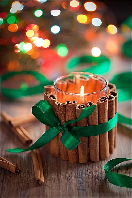 This is such a sweet, beautiful, inexpensive holiday decor idea. I'll definitely be doing it this Christmas. #cinnamon #candles #Christmas #decor #decorations #DIY #crafts #entertaining #ribbon #bows #holidays