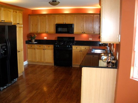 Light Orange Kitchen Walls i sort of like this wall color for my kitchen. my cabinets are