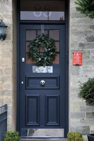 Adrienne's festive front door and railings in F Railings