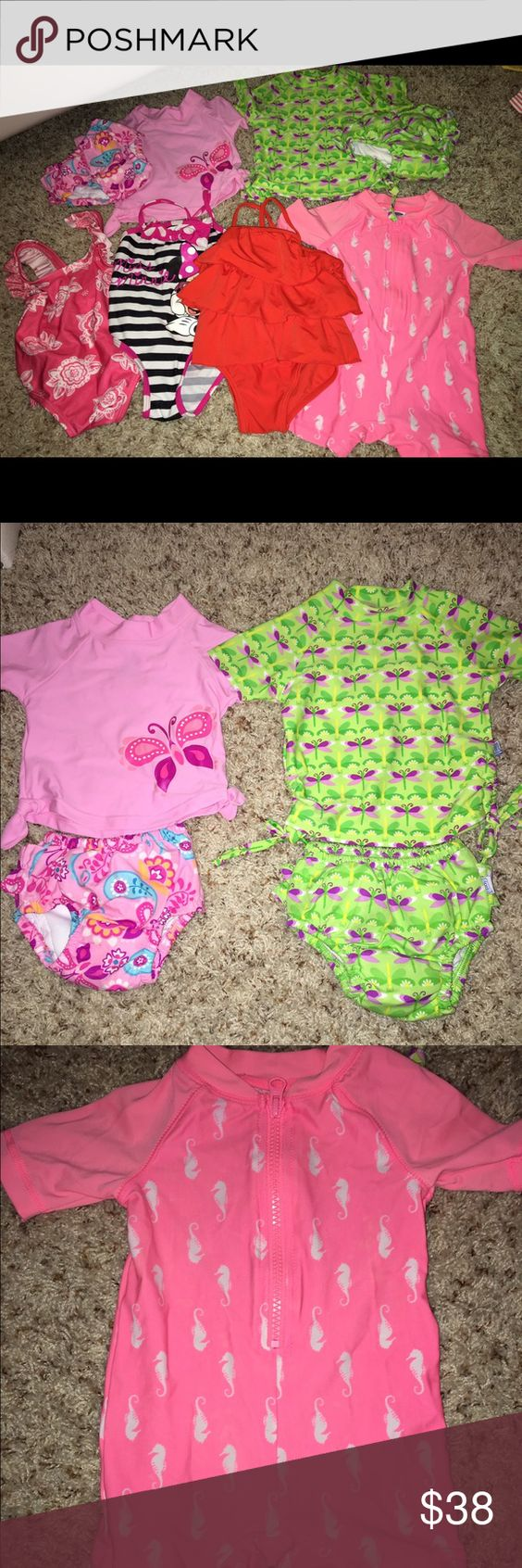 Baby girl lot of swimsuits Two sets of swimsuits including two UV shirts with diaper bottom cover UV spf 50 . Three one piece swim suits, 1 body suit swimsuit and 1 cover up towel Swim One Piece