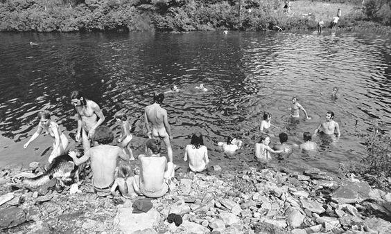 Naked hippies bathing at Woodstock, 1969.