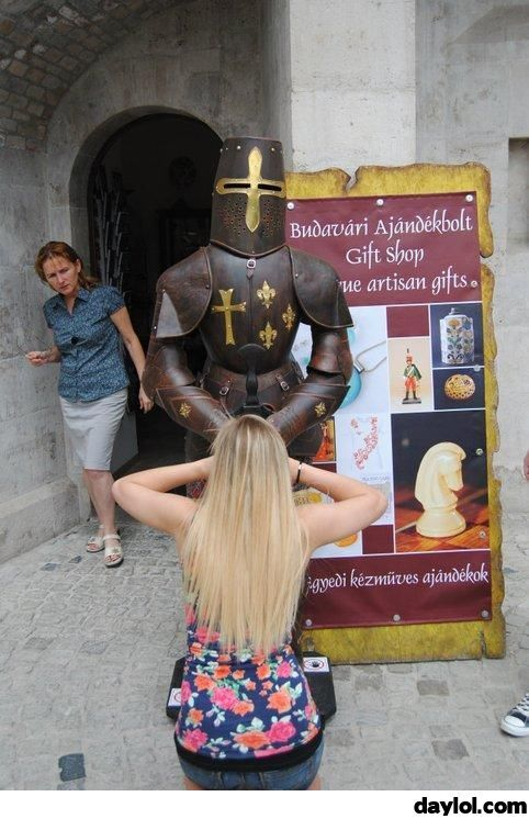 She is reading the inscriptions on his sword - DayLoL.com - Your Daily LoL!