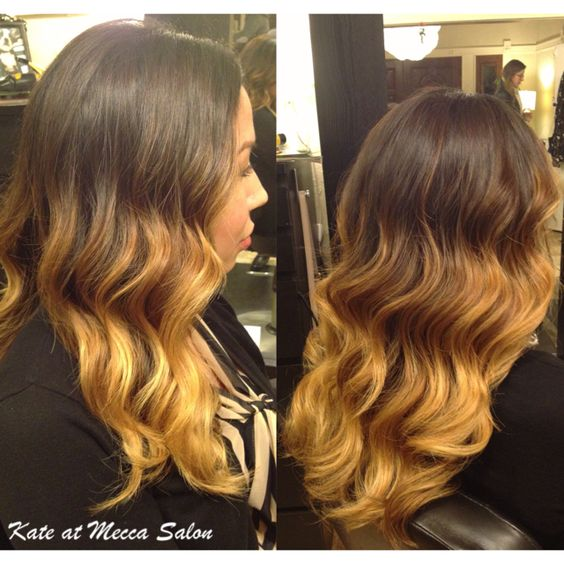The ombré trend is still holding strong. Deep brunette faded into a caramel blonde topped off with long layers and finger waved style curls. #StyledbyKate at Mecca Salon 916-444-2136