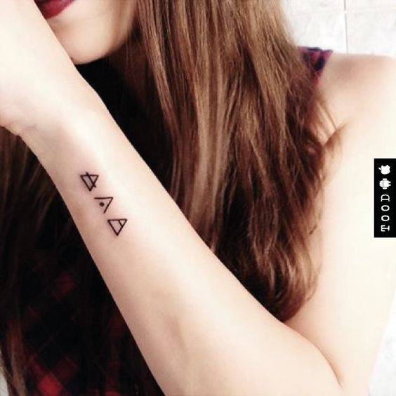 Small triangles patterns temporary tattoo sticker on wrist