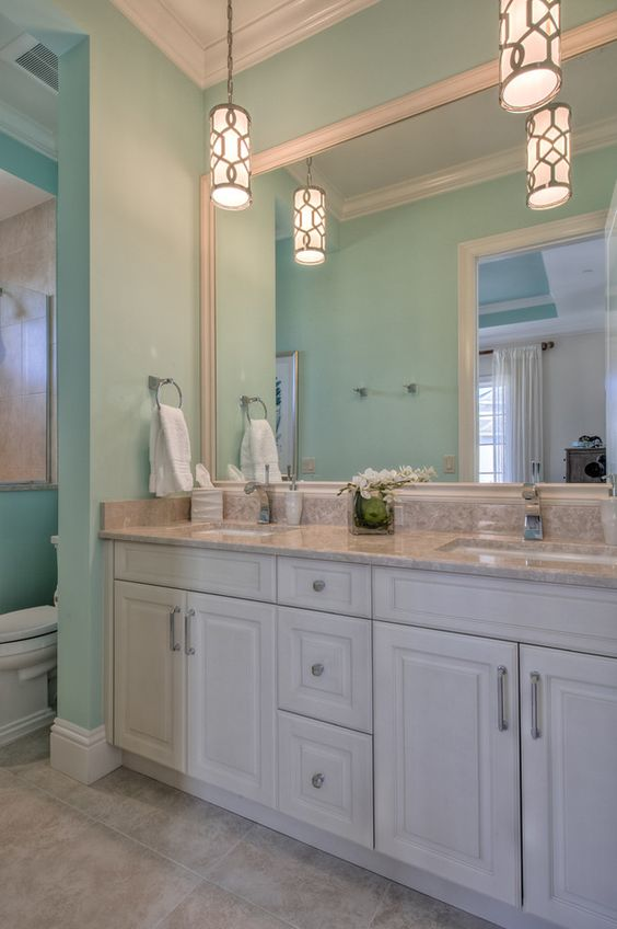 Turquoise bathroom calusa construction interior design for A d interior decoration contractor