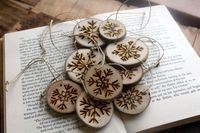 wood burned snowflake ornaments @ Juxtapost.com