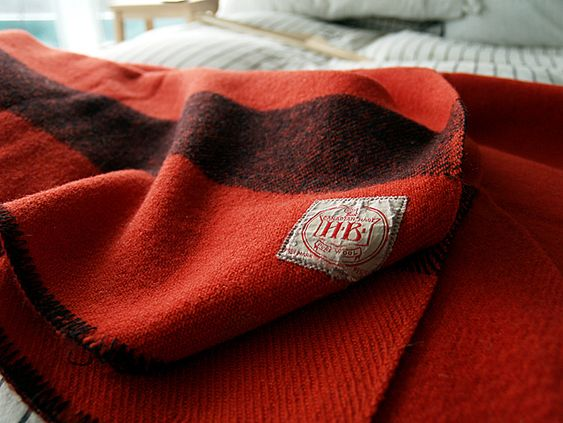 Vintage wool blankets.  I have several army blankets.  They wear like cast iron and can be used to make all sorts of things, including upholstery.