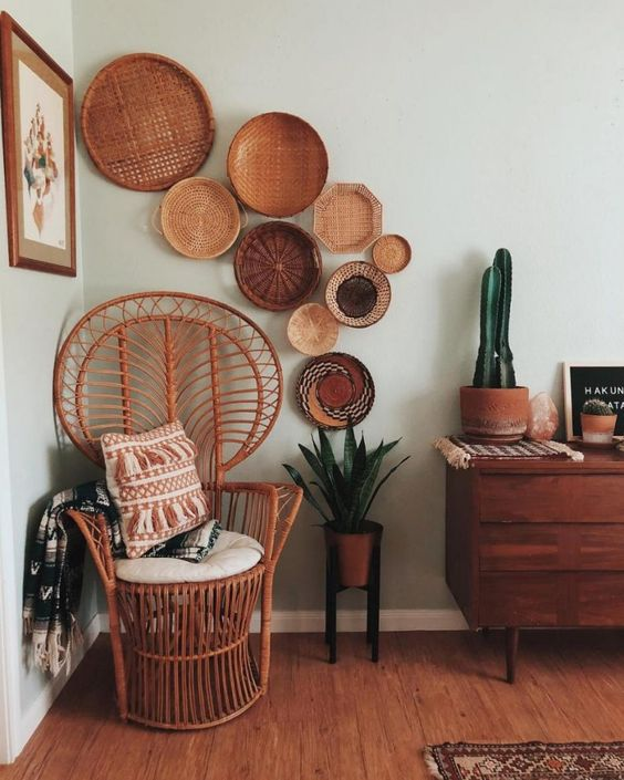 Chic corner featuring a peacock chair and a collection of woven baskets.