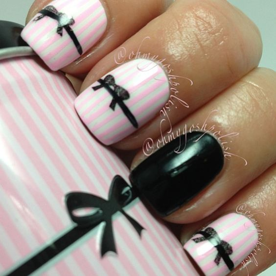 Pink and Black Bow Nails. I would like to point out that that is a tampon can she is holding... BUT CUTE NAILS.
