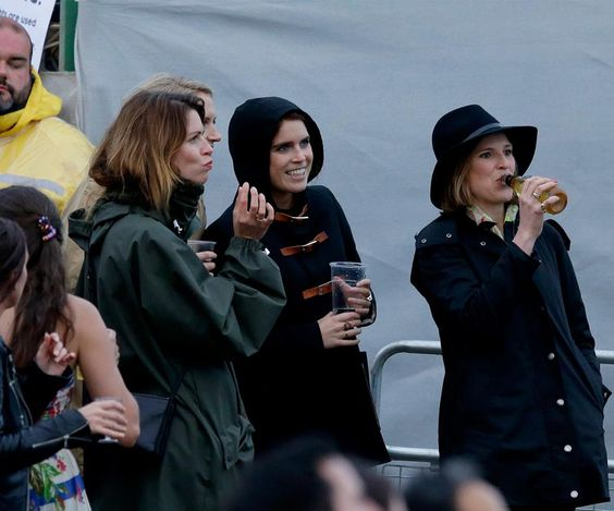 Princess Eugenie braved the rain with her pals to support cousin Harry's charity gig for Sentebale. Coldplay featured along with the Basotho Youth Choir - 28 june 2016.