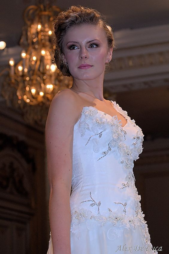 Pictured: is a beautiful model wearing bridal wear by Maria Chiodo, one of the most influential designers in Australia.