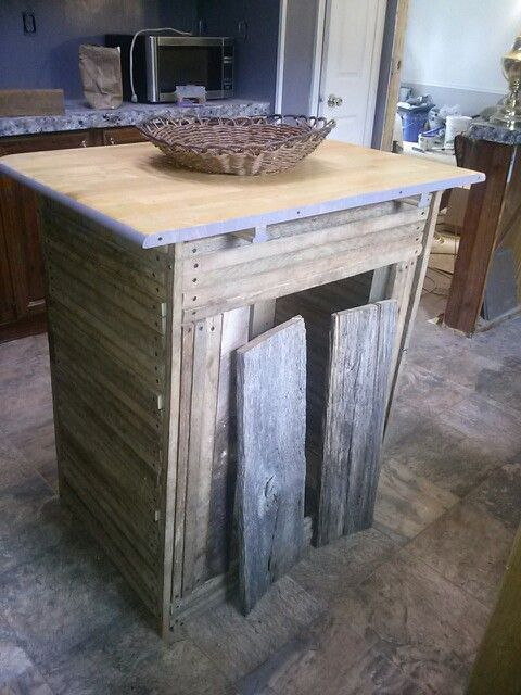 Kitchen island made from tobacco sticks i made with barn wood doors