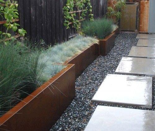 Narrow planter, steppers & gravel.