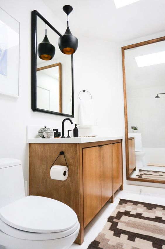 The guest bathroom has a skylight, which brings in gorgeous natural light, but no actual windows. I maximized the light by adding a full-length mirror to one end of the bathroom, as well as an oversized mirror above the sink. Both were purchased at the flea market.
