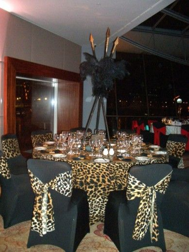 African themed centerpieces sharper solutions african for Animal print party decoration ideas
