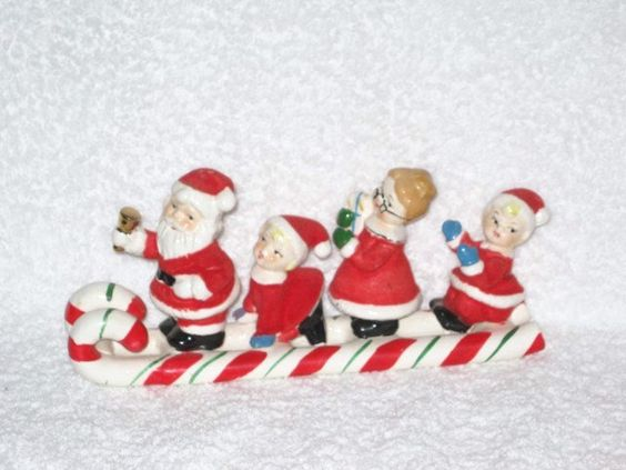 Vintage Christmas Holt Howard Era Napco Ceramic flocked Santa Mrs Claus & Kids Candy Cane Sleigh Hard To Find. $125.00, via Etsy.