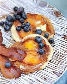 Martha Stewart  pancakes serve with crisp bacon and fresh blueberries.