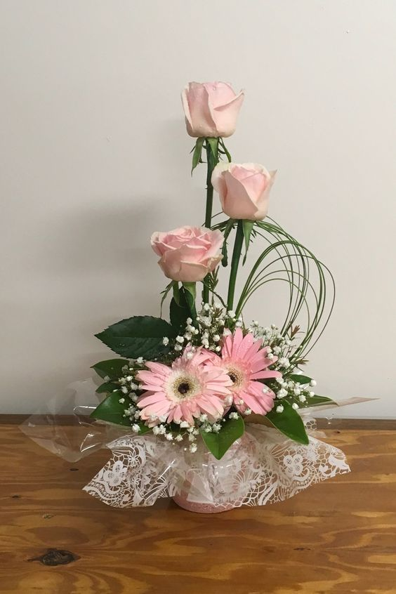 This would make pretty centerpieces with a hydrangea on the bottom and the roses standing up