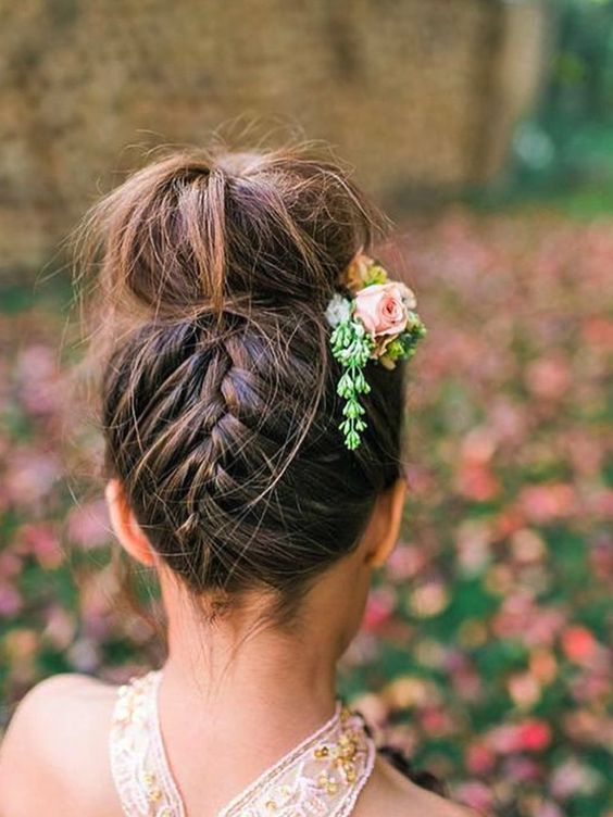 Braided high bun. This amazing bun is both contemporary and romantic. Image: Instagram/@wedding_hairimg #wedding #hair