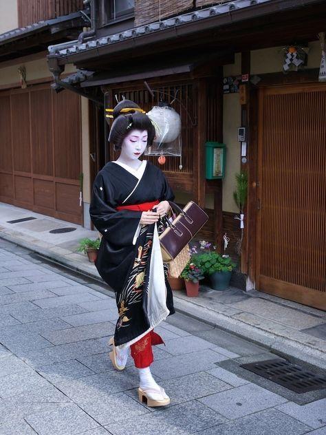 Geiko(geisha) and Cityscape of Kyoto. Her name is Toshikana. #japan #kyoto #kimono #japanese culture