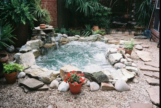 This one is sort of a hot tub but it's surrounded by amazing stones and a waterfall as well. You'll definitely be feeling like you're in a jungle if you go with something like this.