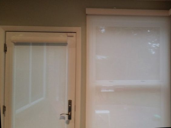 Matching roller shades on door and windows. We have roller shades, solar shades and window shadings. Call us at 419-381-2700