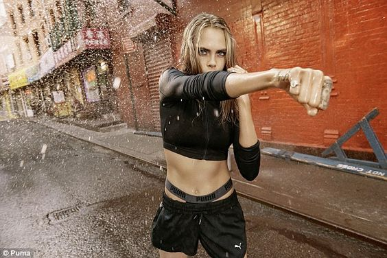 Don't mess with her! Another shot sees Cara sporting thigh-skimming shorts and a long-slee...:
