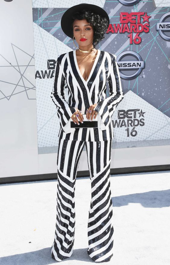 Sydne Style shows how to wear black and white stripes like janelle monae
