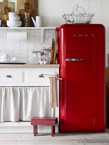 Generally speaking, vintage (and vintage-inspired) appliances have a smaller footprint than modern-day behemoths. They can also add decorative charm—and a welcome pop of color!—in a small space. This 50s-style Smeg refrigerator is just under 24