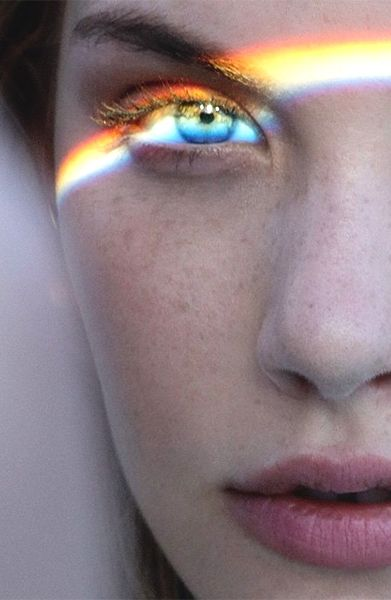 A prism may have been used to split the white light into the different colours of the rainbow.
