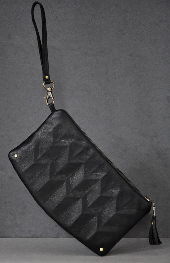 $203 lara kazis · black clutch