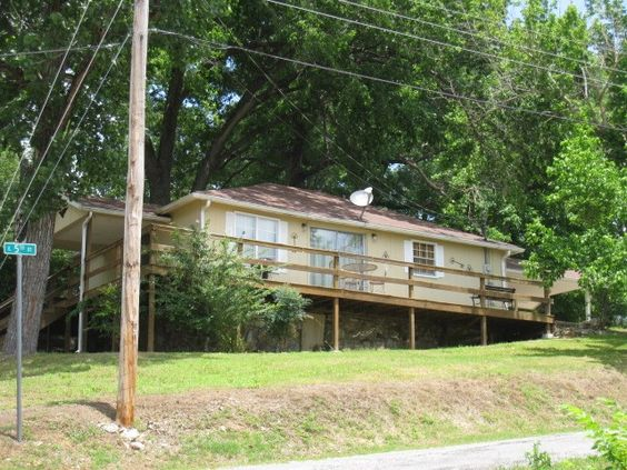 CLEAN, 1-BEDROOM, 1-BATH COTTAGE with a wrap-around deck and 3 lots. IDEAL FOR A WEEK-END-GET-AWAY OR CALL IT HOME in Hardy AR