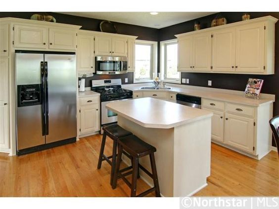 Kitchen: These were golden oak cabinets (color of the floor) that ...