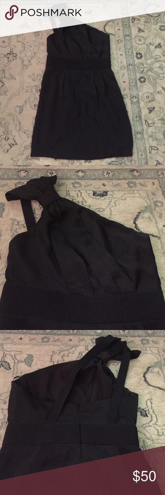 """Gorgeous black one shoulder dress BCBG Generation 1 shoulder (right side) black short dress, size 4. Has some pleating pleating on top and around waist band. Pleated shoulder detail (almost like a bow). Right shoulder detail turns into 2 (stretchy like) straps that adhere to back of dress. Worn only 1x, still has """"hanger straps"""" to not pull on shoulder strap when in closet. Has lining material (pic 4).100% polyester. Has some boning on top area for support. Back zip. Perfect for cocktail…"""