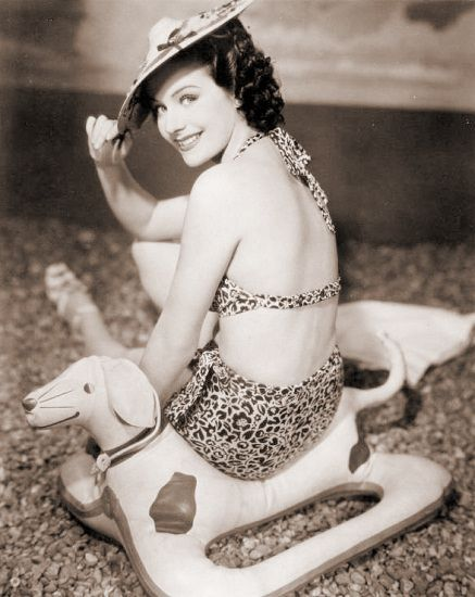 actress Margaret Lockwood on Doxie seat/float