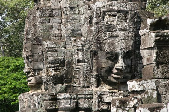 Bayon - Cambodia; In Bayon, you feel surrounded by enigmatic smiles of more than 200 massive faces. DO cycle in Angkor Thom and Bayon DON'T miss the sunrise around 4.30am.