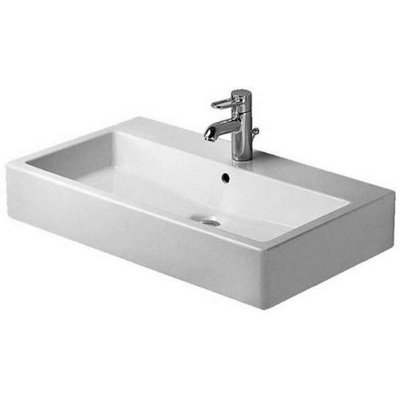 Add the perfect porcelain touch to your contemporary bathroom with this beautiful 31-1/2-inch-wide Duravit Vero washbasin. The antimicrobial piece comes with three precut tap holes and an overflow for easy installation in your washroom.