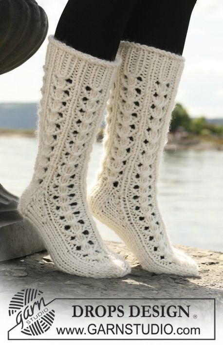 "Long DROPS socks in ""Eskimo"" with lace pattern. ~ DROPS Design"