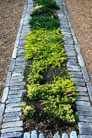 Image result for driveway with loads of flowers