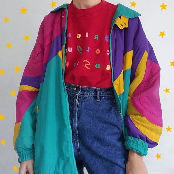 Person posing in colorful windbreaker