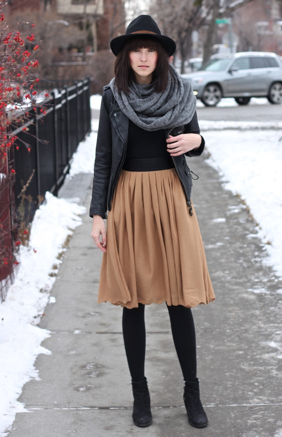 winter outfit, woman outfit, tan pleated skirt, black tights, black booties, gray scarf