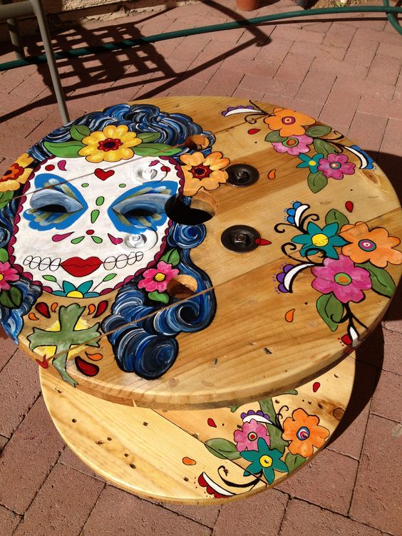 "Mexican skull face one of my favorite table I painted. (cable ""spool"" table)"