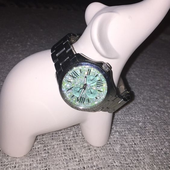 Beautiful fossil watch Gorgeous sterling silver stainless steel watch large face with in's seafoam green with diamond encrusted. Needs to be polished in the clasp needs to be buffed a little from wear Fossil Accessories Watches