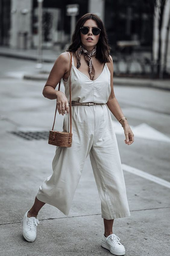 Cropped jumpsuit + skinny belt + platform sneakers. 7 Summer Outfits That Make You Look 10 Pounds Lighter #purewow #summer #style #outfit ideas #fashion #platformsneakers #platforms