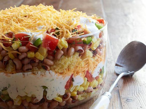 Boasting layer upon layer of Tex-Mex ingredients, like black-eyed peas, corn and a chili-lime mayonnaise, this 20-Minute Cornbread Salad is a savory take on a classic trifle. #FNMag #RecipeOfTheDay
